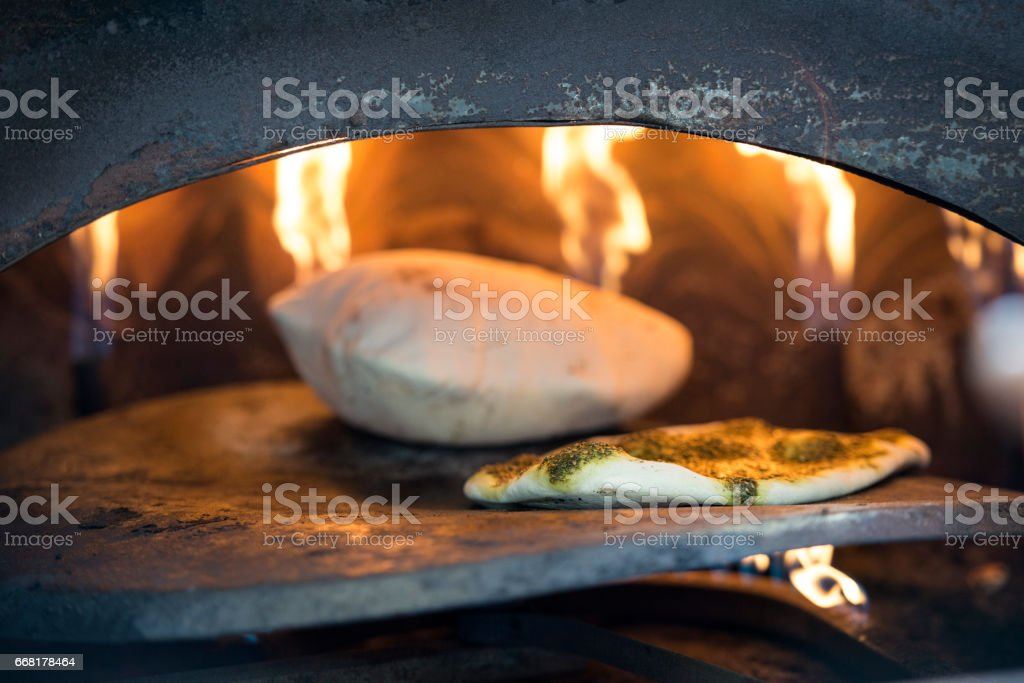 Bread baking in Taboon oven. stock photo
