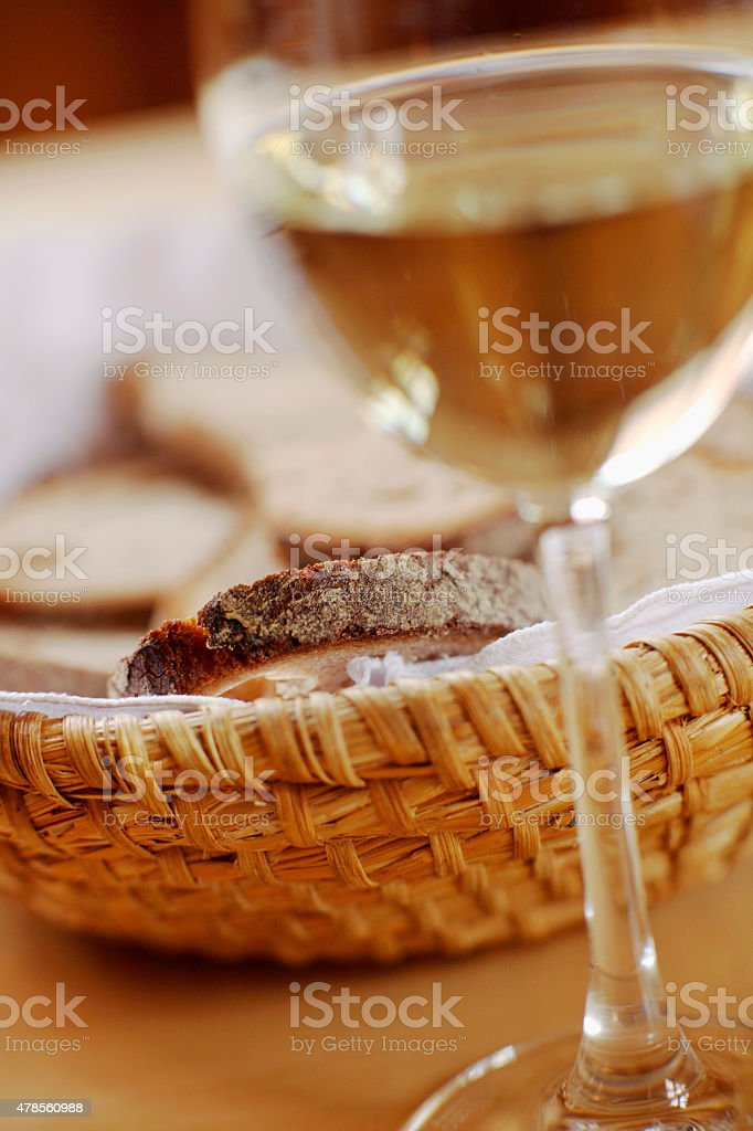 Bread basket and glass of wine stock photo