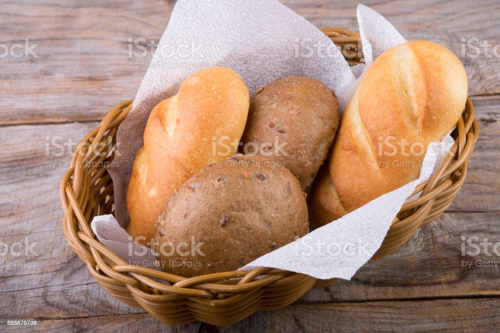 Bread basket on a wooden board stock photo