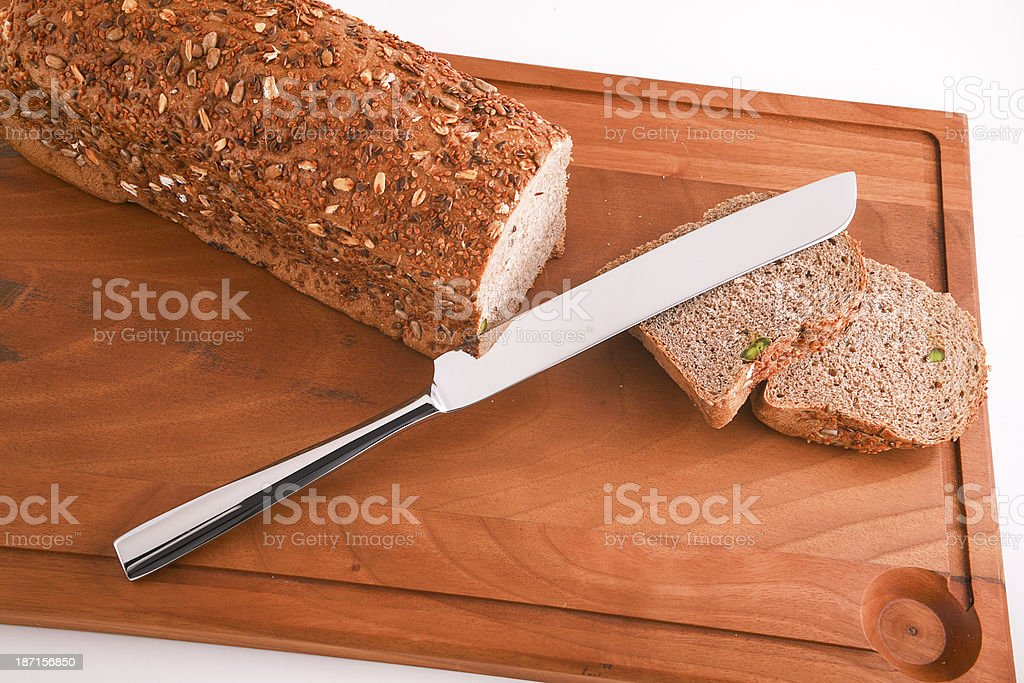 Bread, Board and Knife stock photo