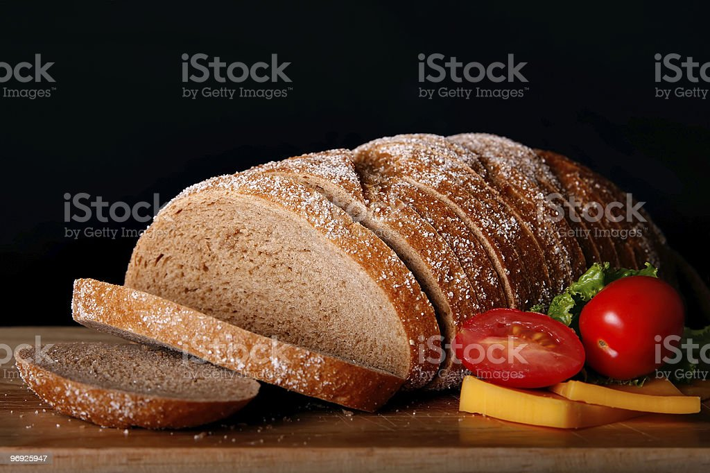 Bread board with tomatoes, cheese and lettuce royalty-free stock photo