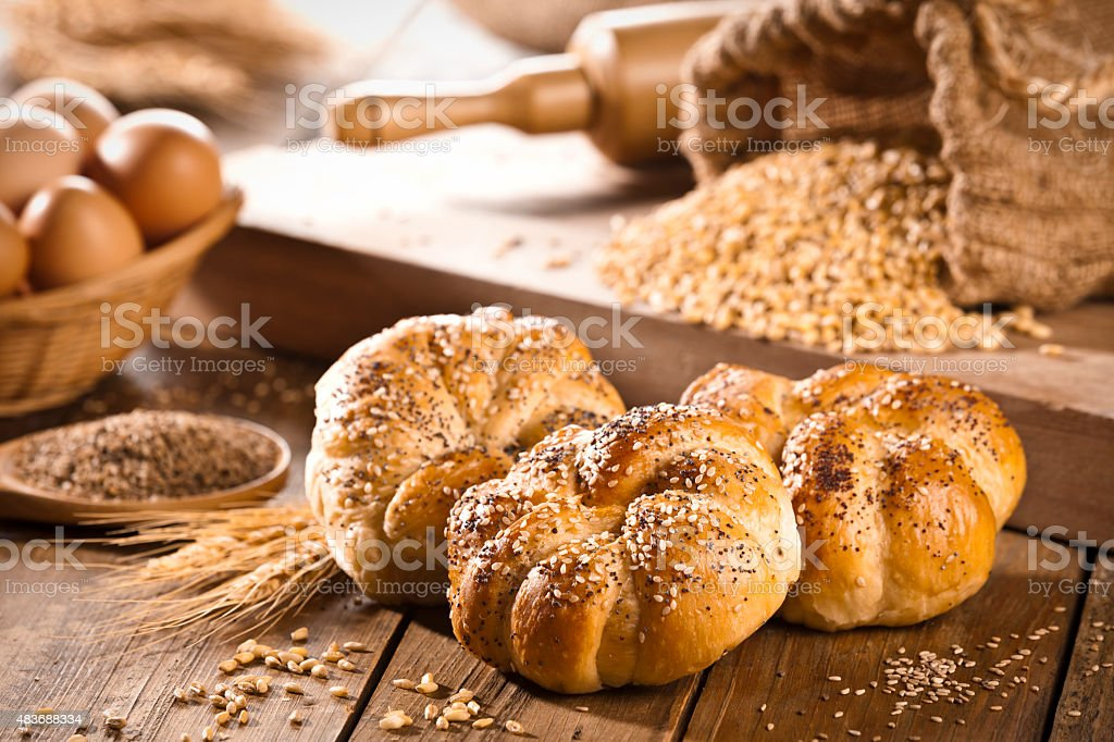 Bread buns on rustic wood table stock photo
