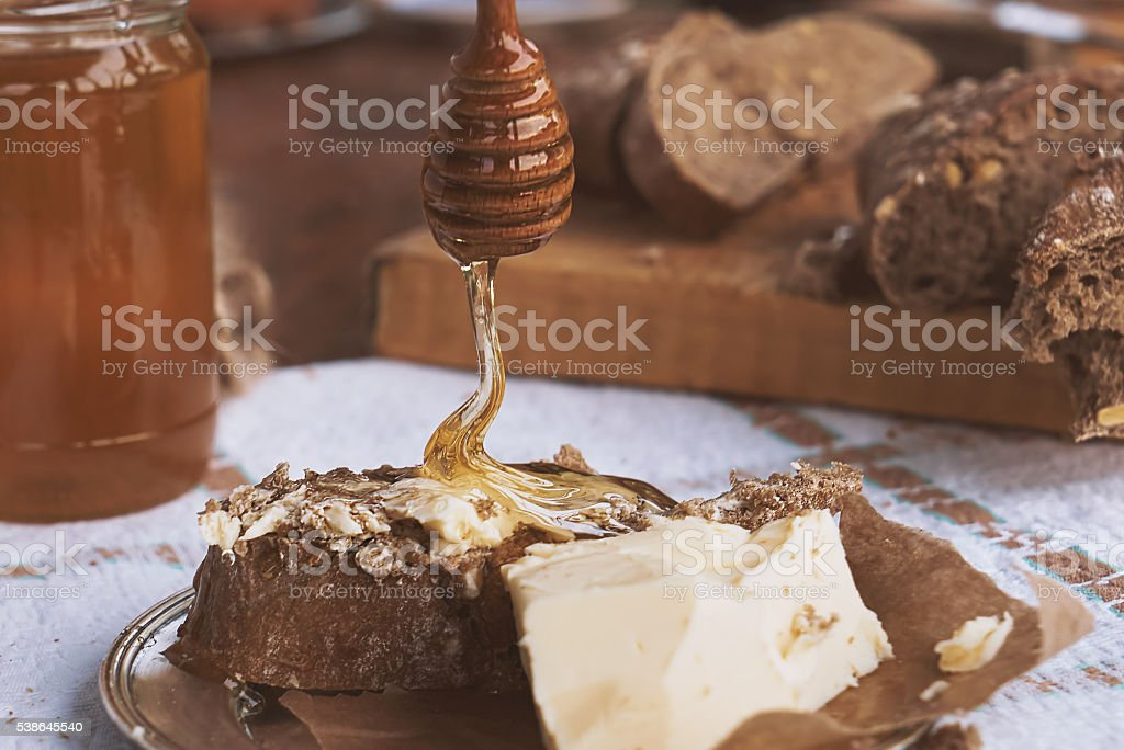bread, butter and honey - closeup stock photo