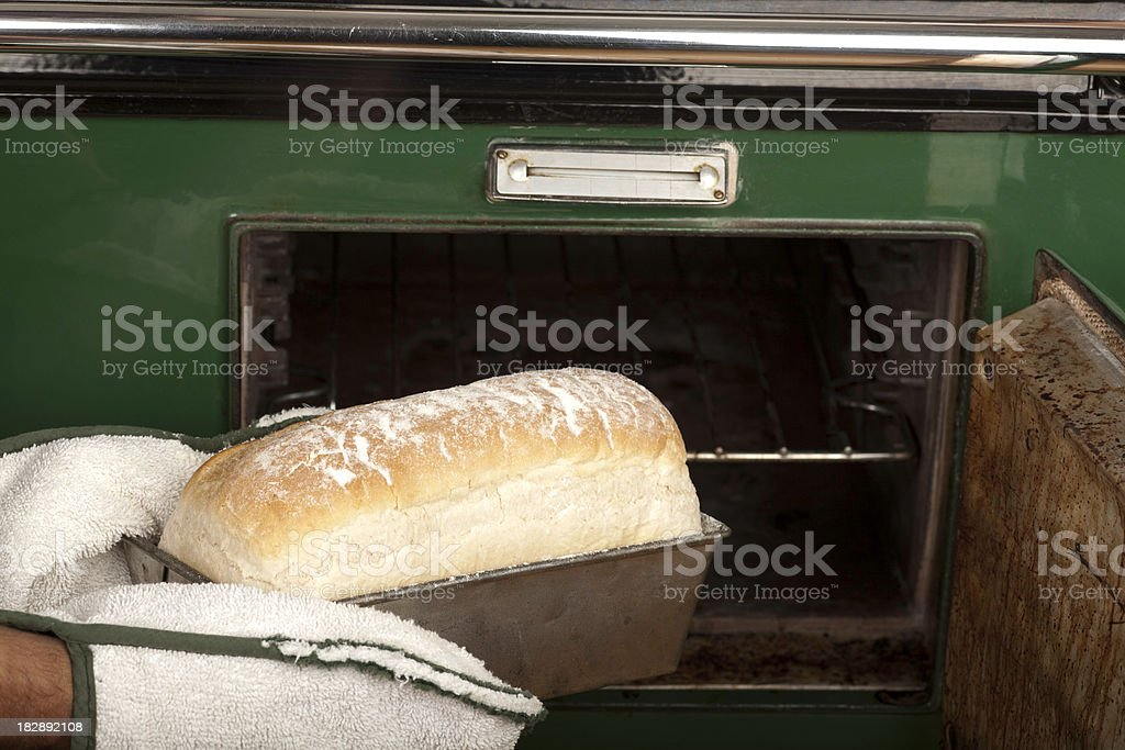 Bread coming out of oven stock photo