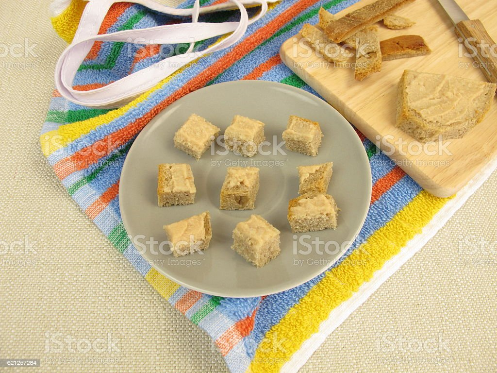 Bread cubes with pate as finger food for toddlers stock photo