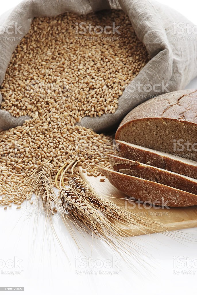 Bread cut on a board and bag with wheat royalty-free stock photo