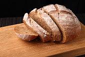 bread, cut on an oak board