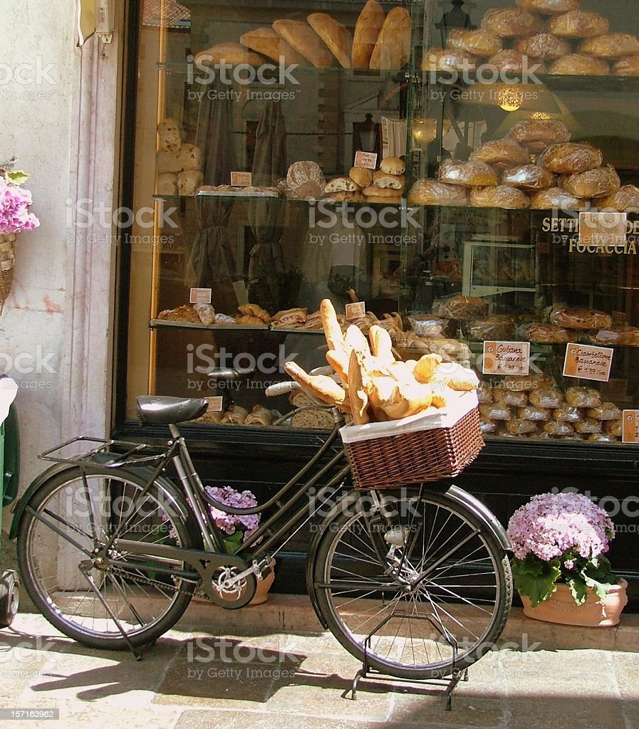 Bread Delivery Bike with Bakery Window- bread loaves in basket stock photo