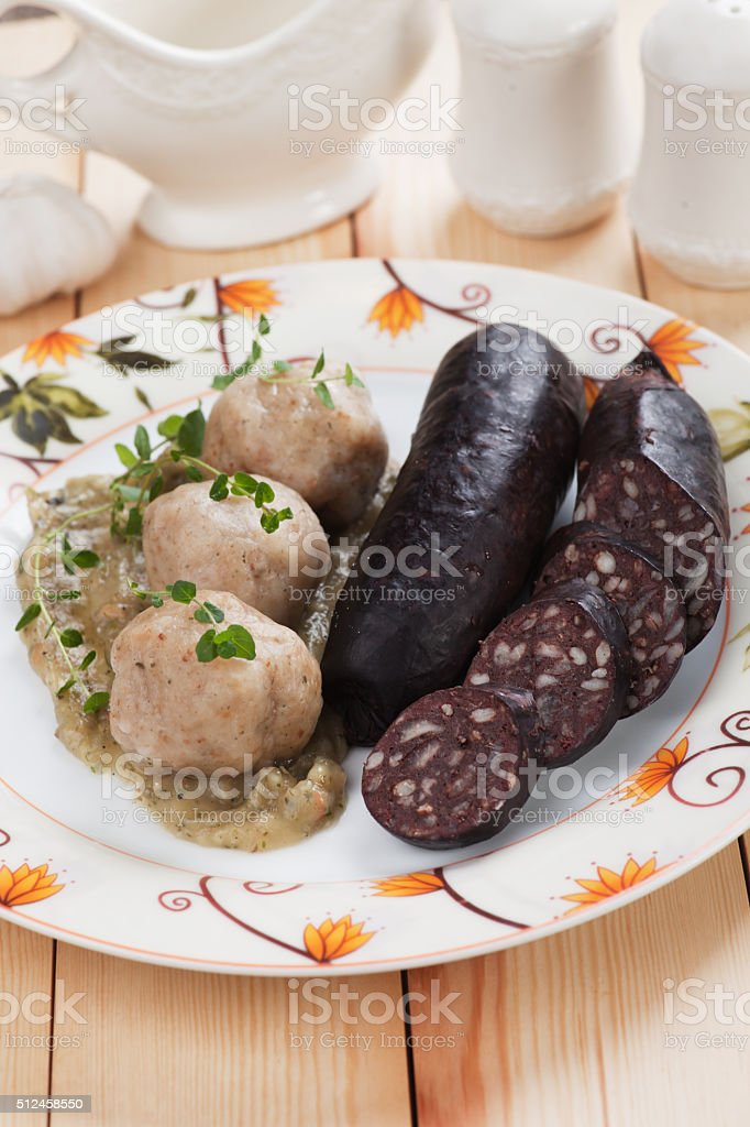 Bread dumplings with blood sausage stock photo
