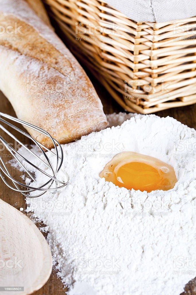 bread, flour, eggs and kitchen utensil royalty-free stock photo