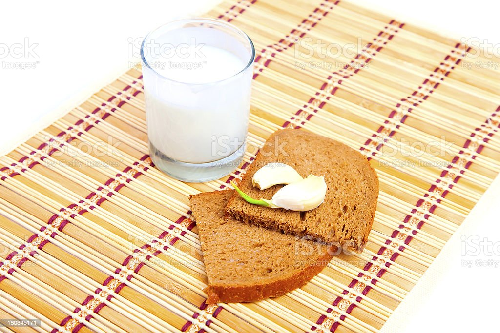Bread, garlic and glass of milk royalty-free stock photo