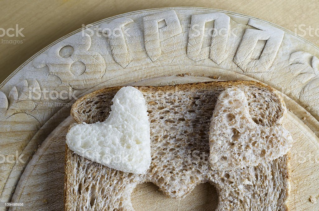 Bread Hearts on Vintage Breadboard stock photo