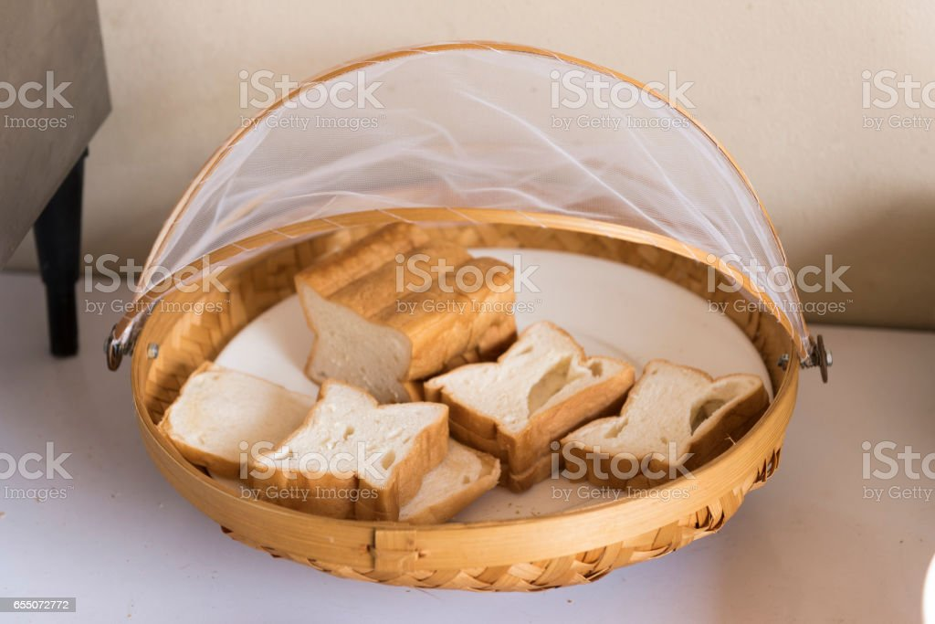 Bread in bamboo weave tray isolated on background stock photo