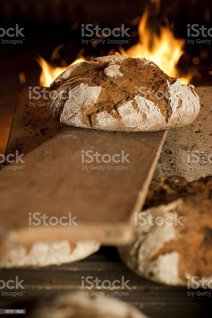 Bread in oven stock photo