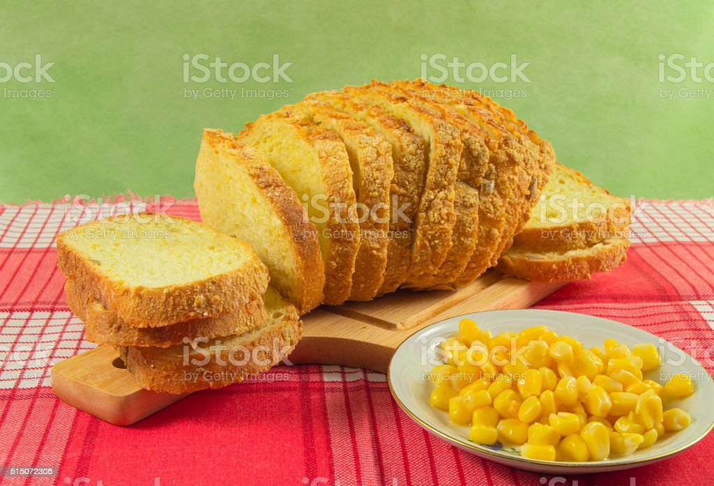 Bread made from corn. Whole grains are in a bowl stock photo
