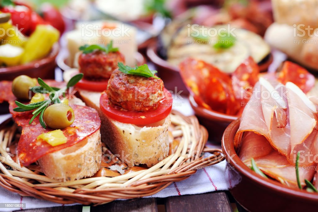 Bread, meat and cheese arranged on small plates stock photo