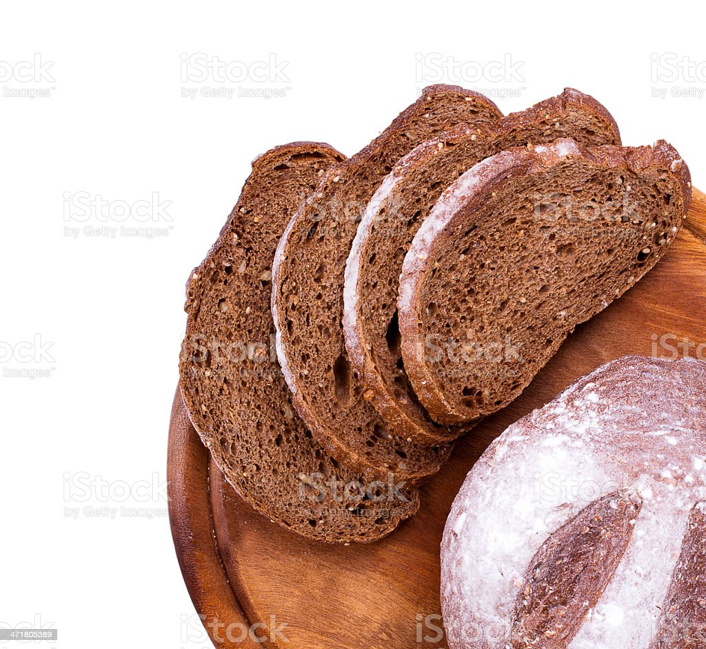 Bread on a wooden tray isolated stock photo