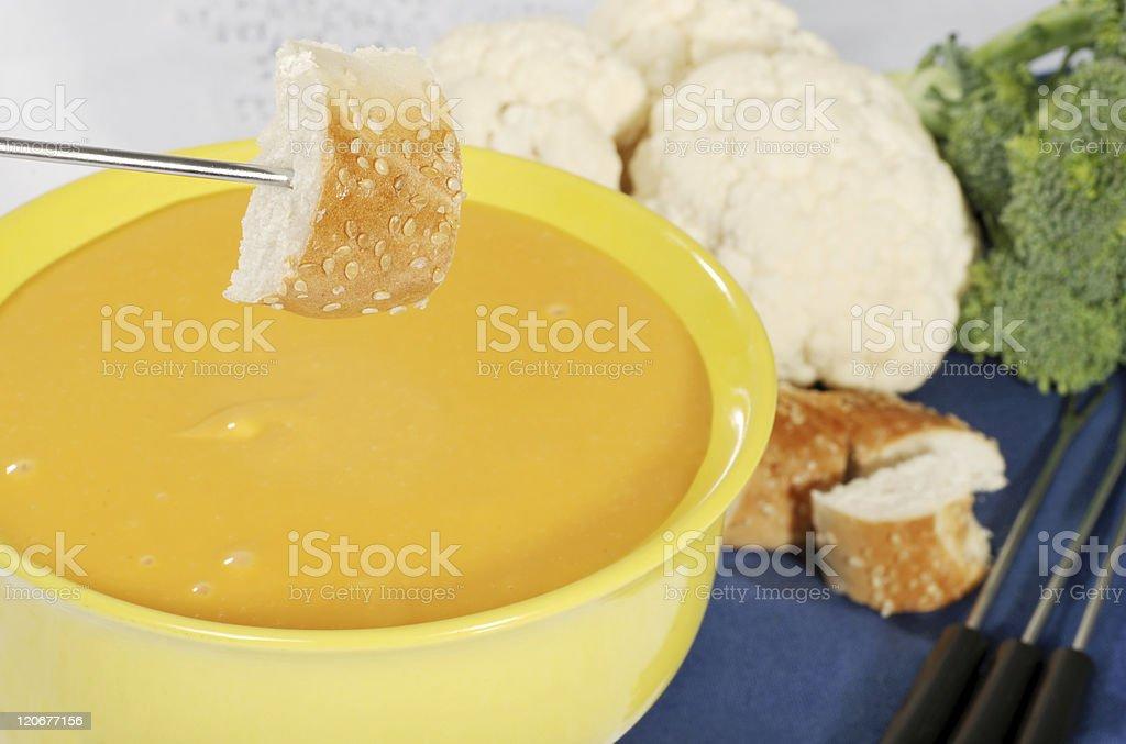 bread on fondue fork stock photo