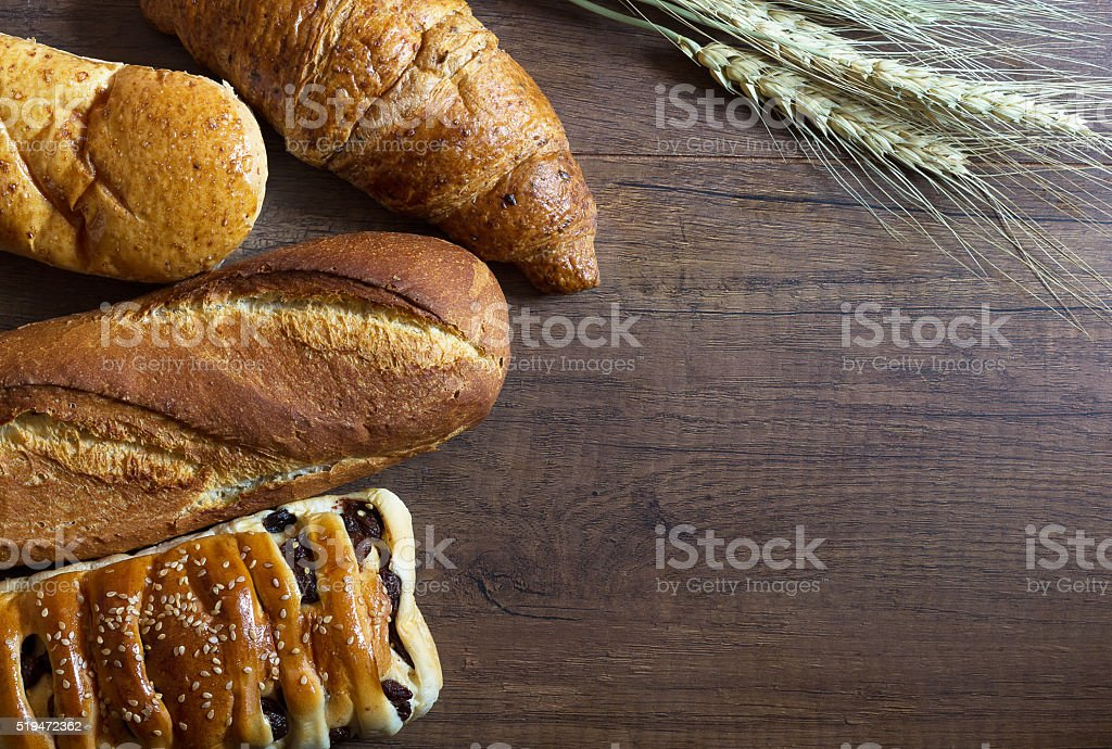 Bread on Wood Background stock photo