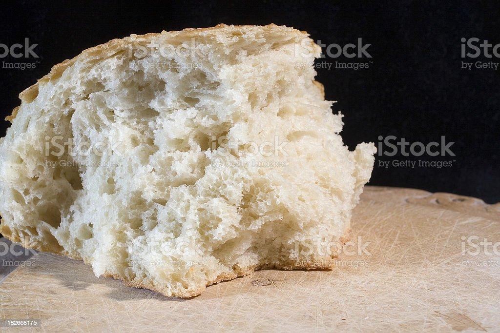 bread on wood board stock photo