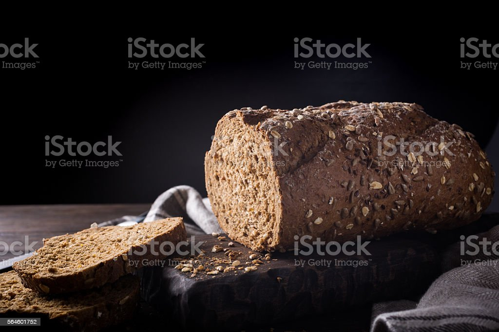 Bread on wooden cutting board stock photo