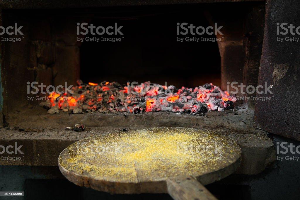 Bread peel in front of brick oven stock photo