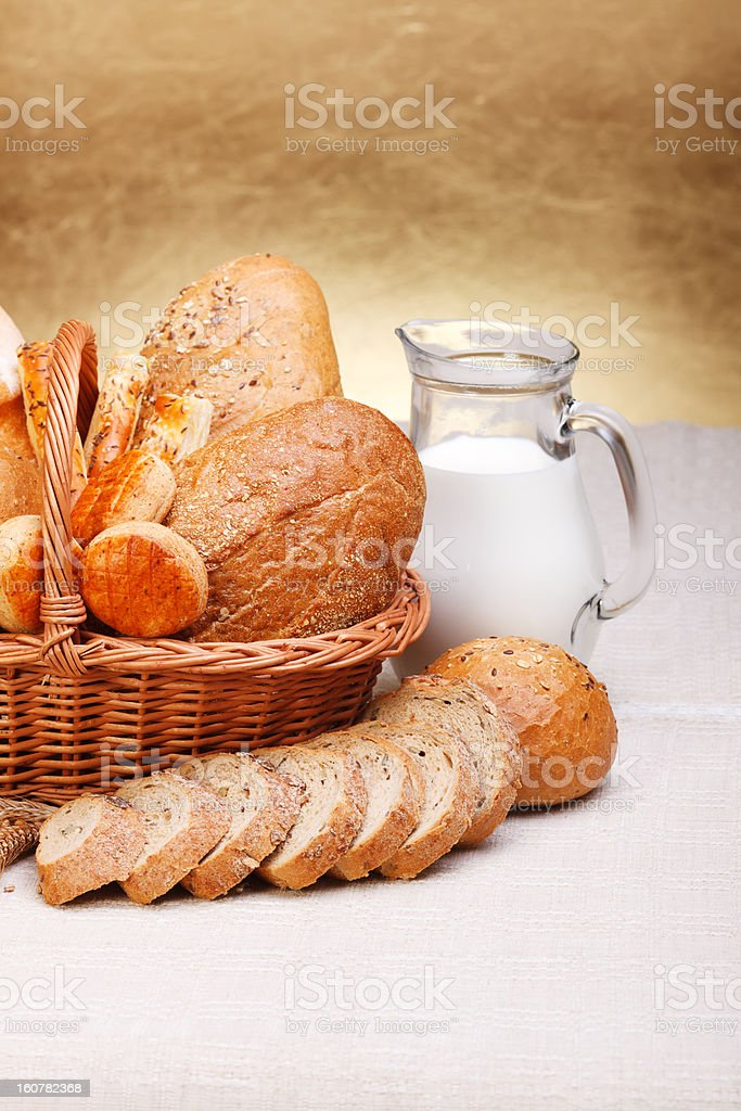 Bread products in basket and jug of milk royalty-free stock photo