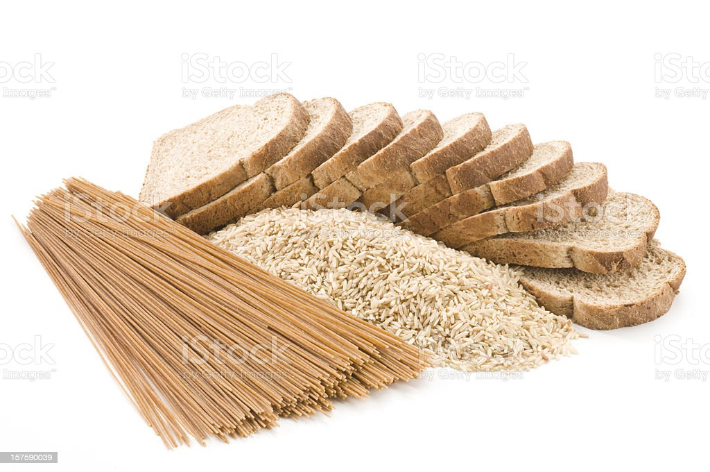 Bread, rice and pasta from whole grains on white backdrop royalty-free stock photo
