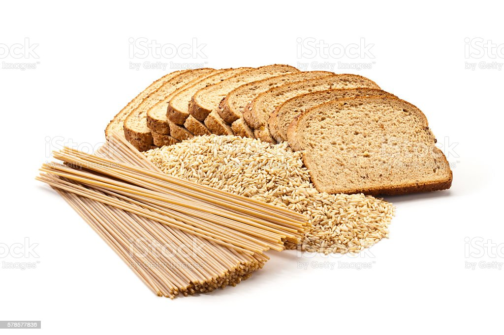 Bread, rice and pasta from whole grains on white backdrop stock photo