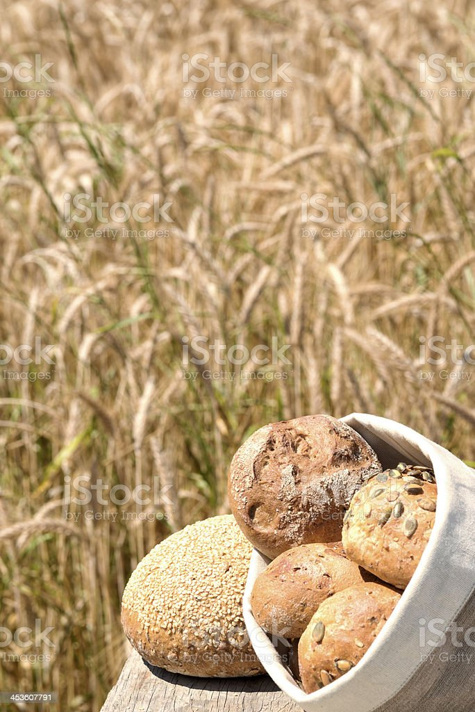 Bread Rolls in front of a field stock photo