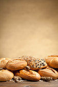 Bread rolls on brown blurred background