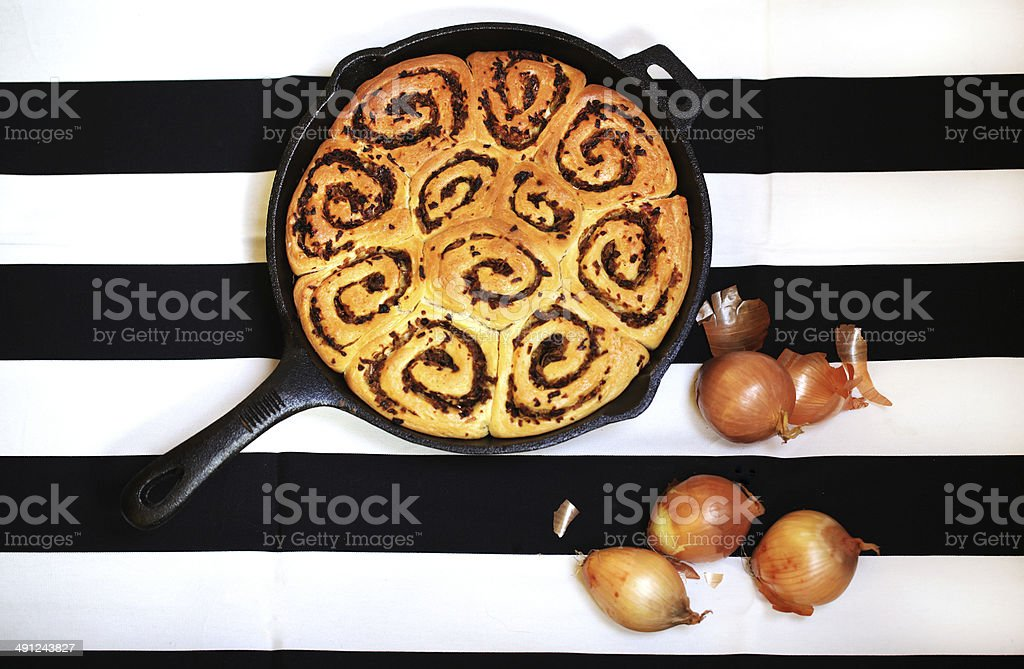 Bread rolls with onion, rolled buns baked in iron pan royalty-free stock photo