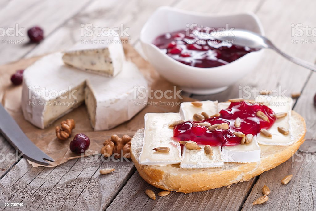 bread served with camembert and cranberry. stock photo