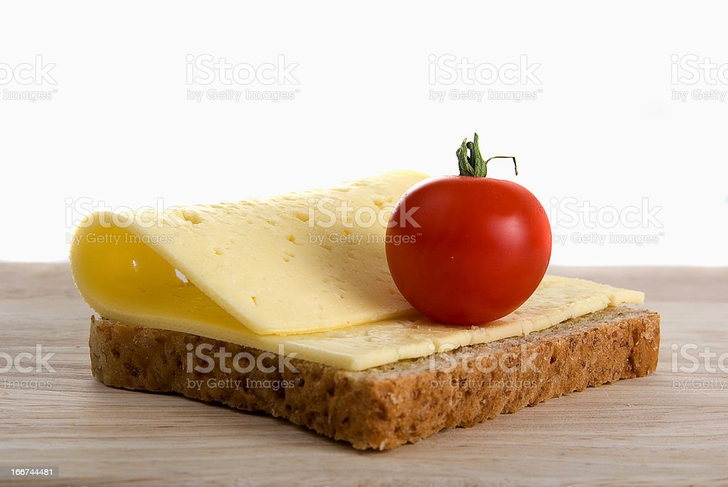 bread slice with cheese cherry tomato on wooden board royalty-free stock photo