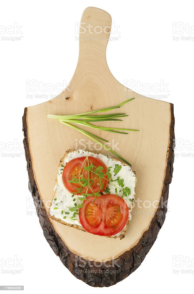 Bread slices with cream and tomatoes on the wood board royalty-free stock photo