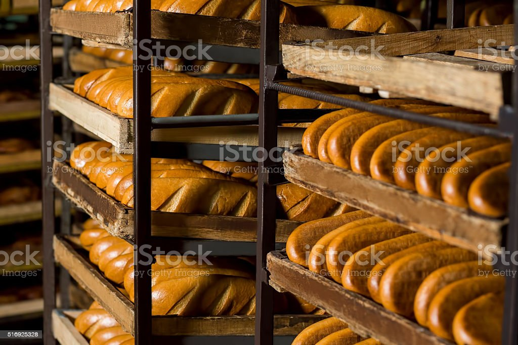 Bread stacked on the shelves. stock photo