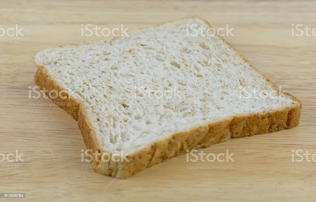 Bread whole wheat on wood background stock photo
