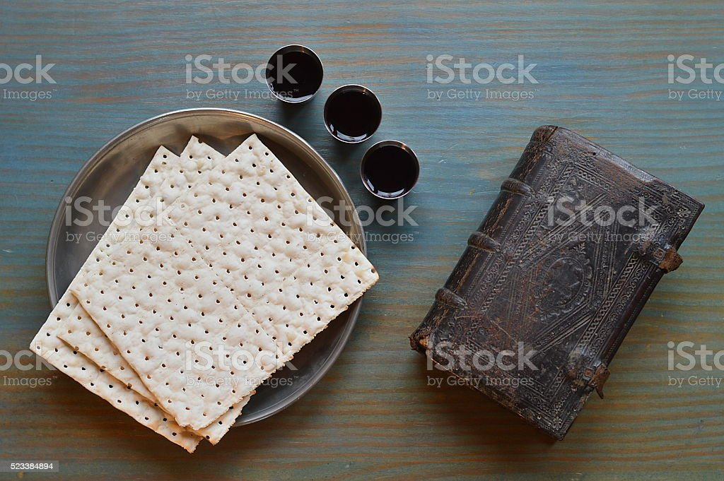 bread, wine and an ancient bible stock photo