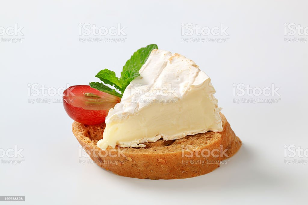 bread with a camembert cheese stock photo
