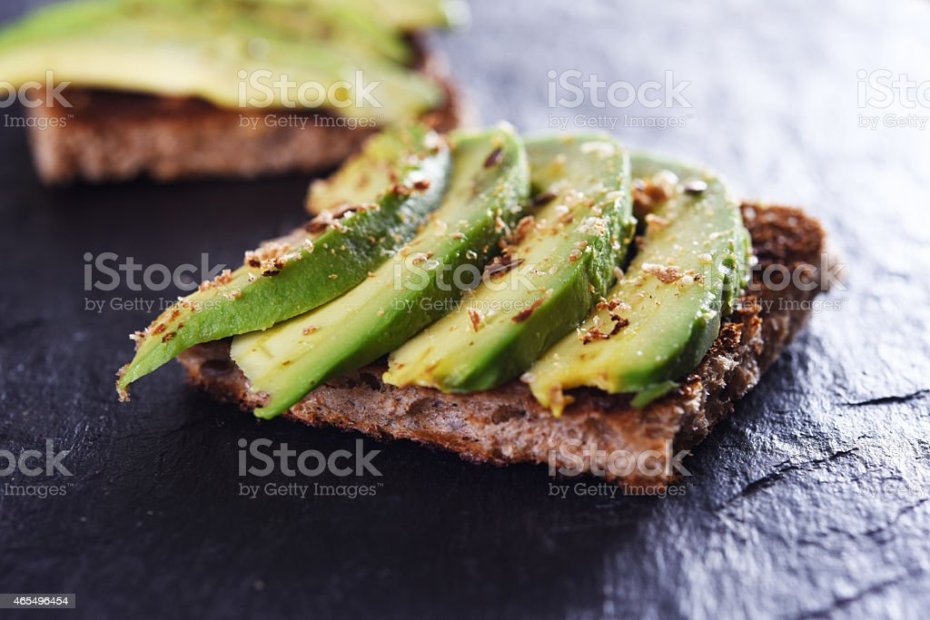 bread with avocado stock photo