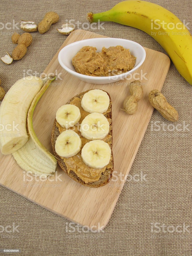 Bread with banana and peanut butter stock photo