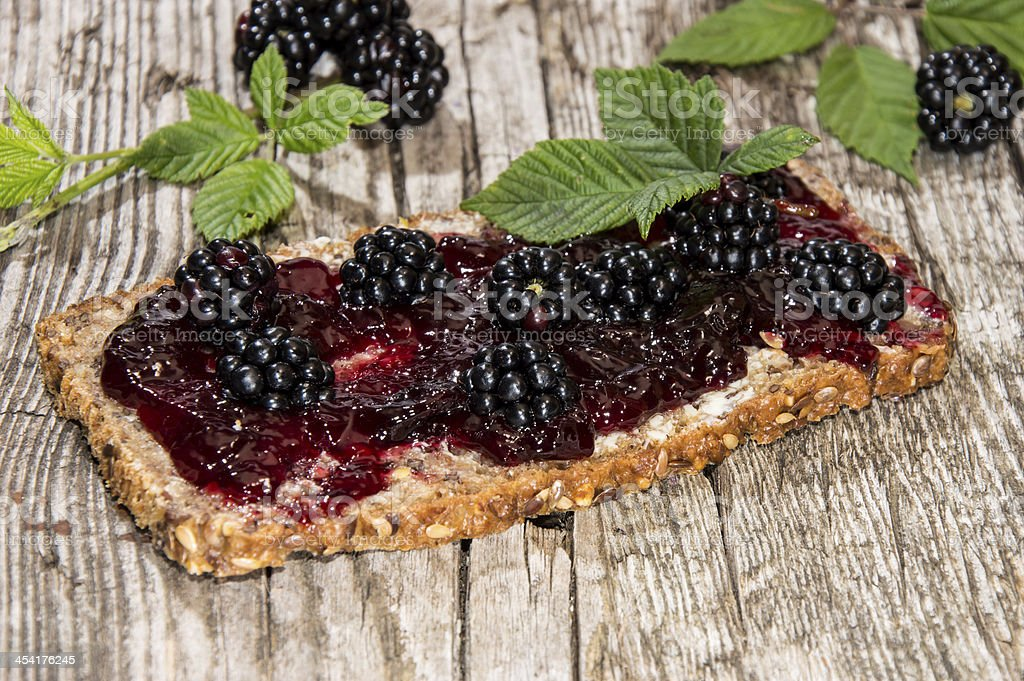 Bread with Blackberry Jam on wood stock photo