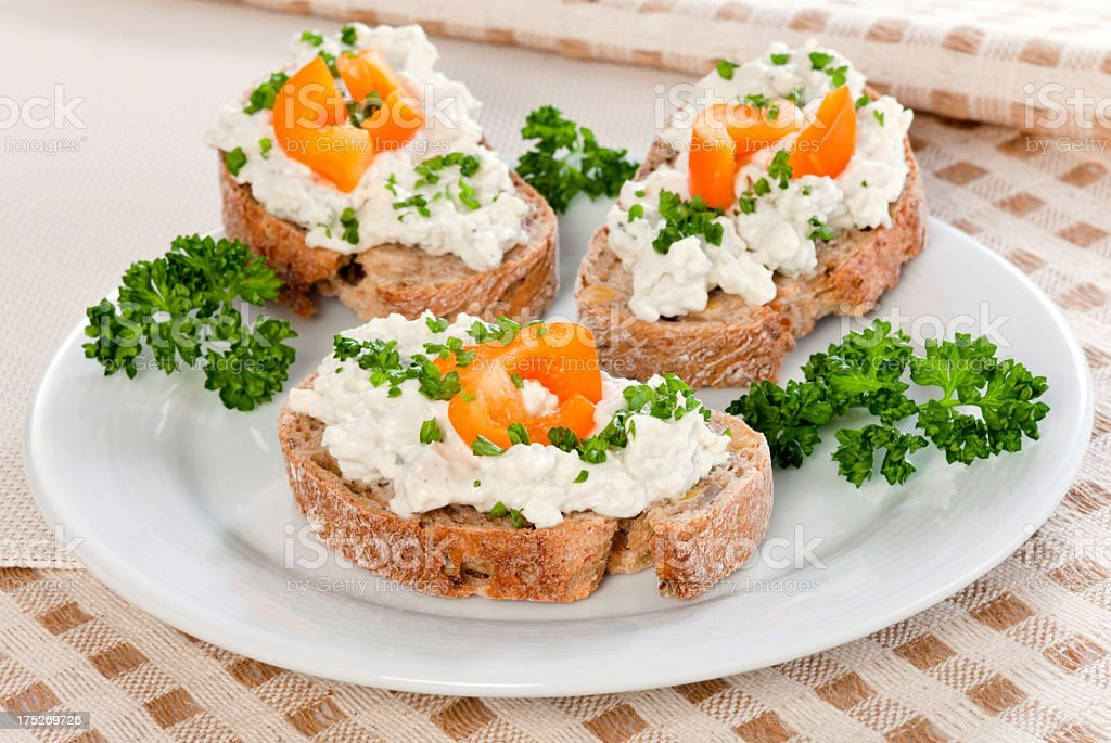 Bread with cheese spread stock photo