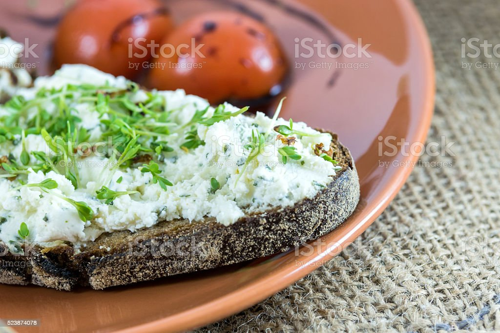 Bread with cream cheese and garden cress stock photo