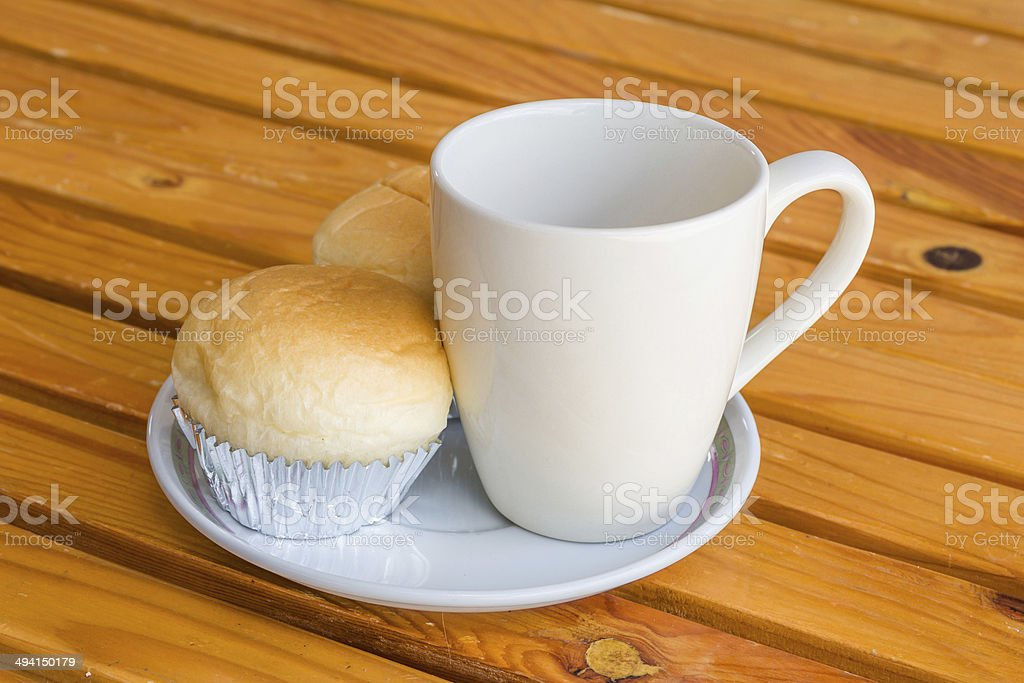 Bread with empty cup of coffee on the wood table royalty-free stock photo