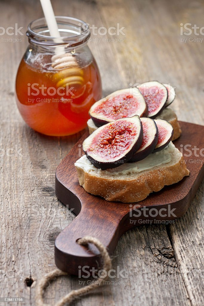 bread with figs, ricotta stock photo