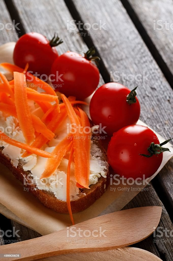 Bread with fresh cheese on rustic table stock photo