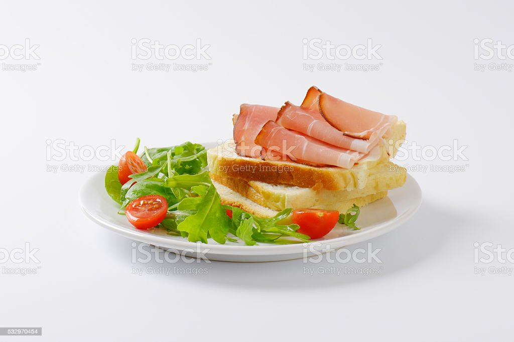 bread with ham and salad greens stock photo