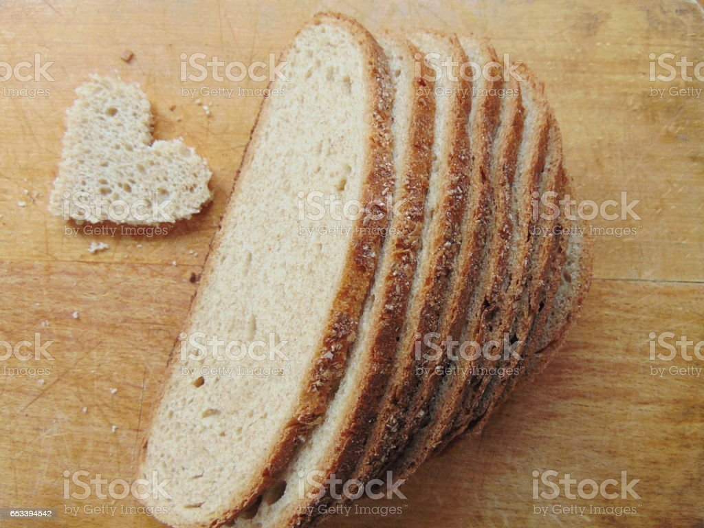 Bread with heart cut out of slice stock photo