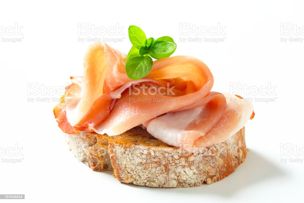 Bread with prosciutto stock photo